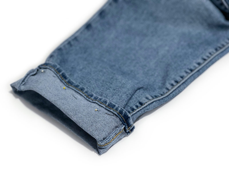 Jeans cuffed & pinned to show how to measure inseam for tailoring without a tape.