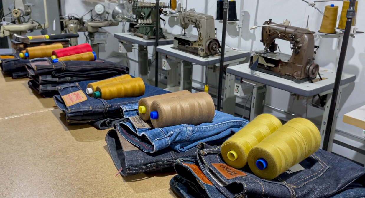 Denim jeans in line for alteration services for chain stitch hemming inside the Williamsburg Garment Co. studio in Greenpoint, Brooklyn, NY.