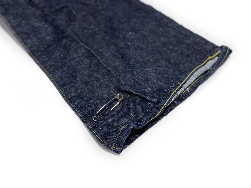 Tips how to measure inseam on jeans by marking with a safety pin for hemming.