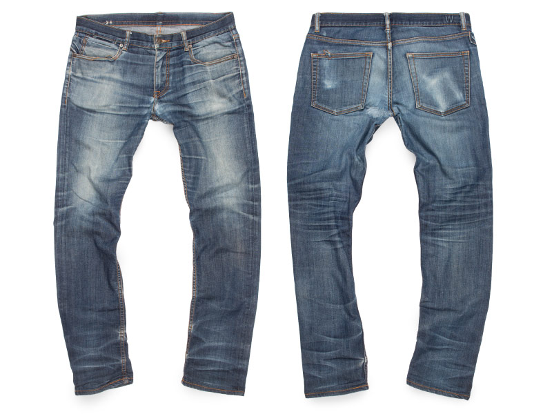 Light blue faded jeans from raw with wallet aging & wiskers