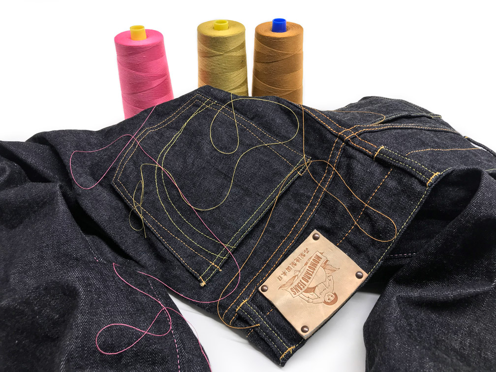 Review recent work tailoring Momotaro jeans with chain stitch hemming