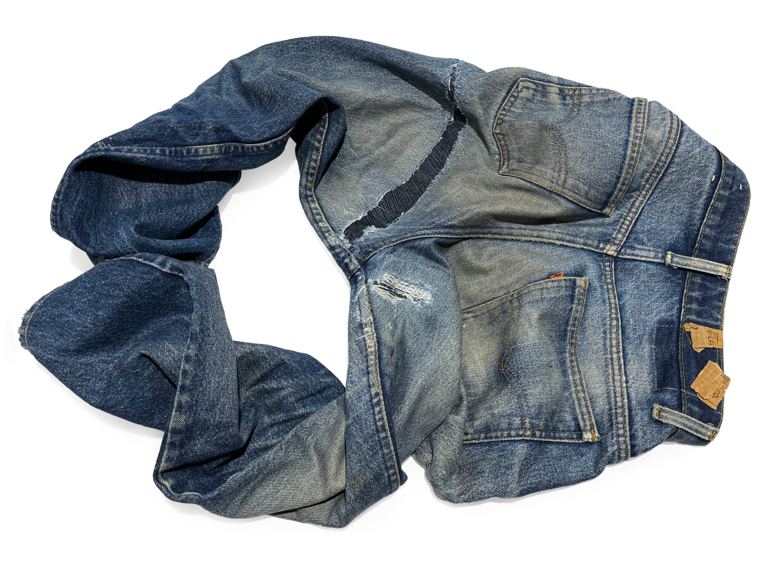 Old Levi's jeans with holes in the crotch repaired