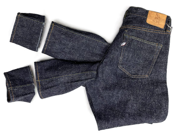 Review the recent work tailoring on Pure Blue Japan jeans with chain stitch hemming