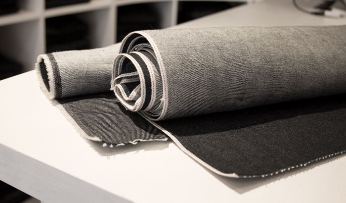 Example of raw denim, selvedge & non-selvedge denim fabric on rolls