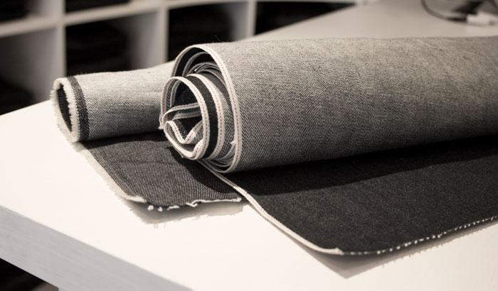 Example of raw denim, selvedge & non-selvedge denim fabric on rolls