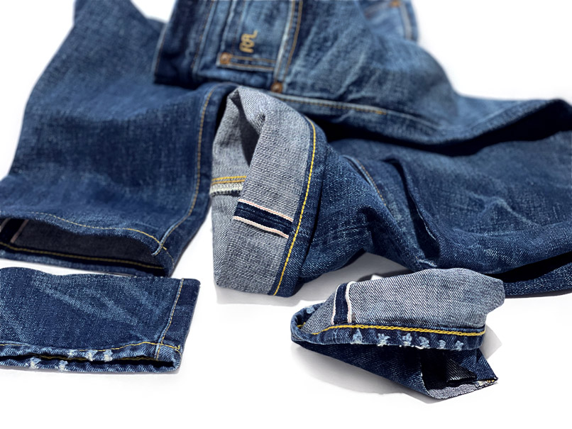 Close-up of RRL jeans with same day, one hour alterations express service chain stitch hemming