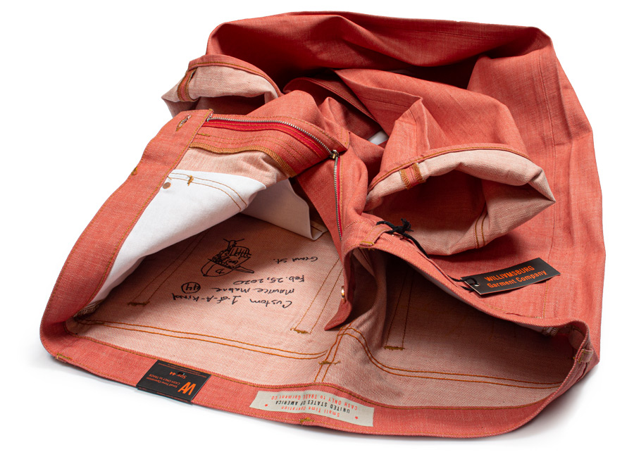 Salmon red raw denim jeans size 44 handmade in Brooklyn, NY and 1-of-a-kind .
