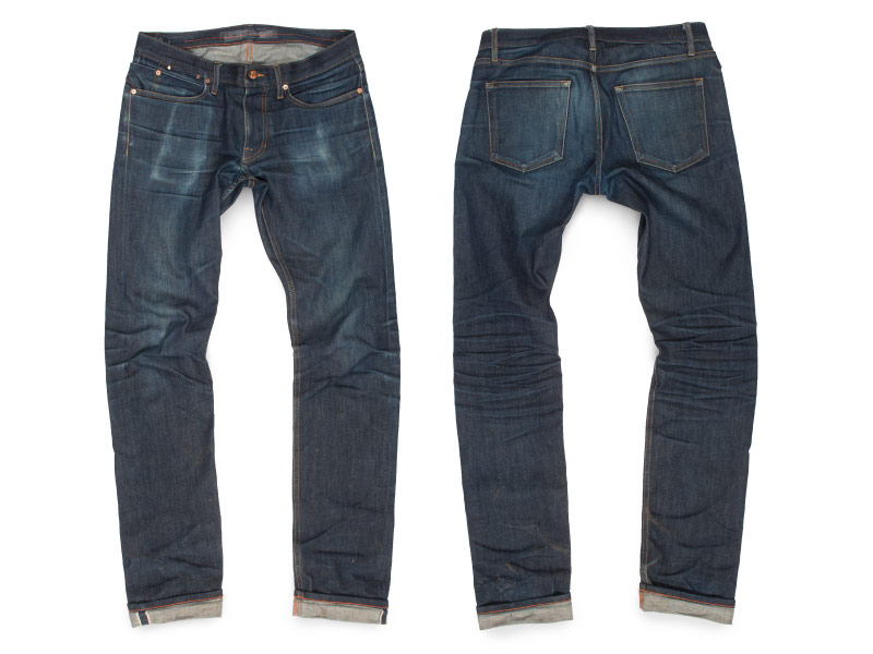 Un-washed naturally aged raw denim jeans with mobil abrasion spot at front pocket