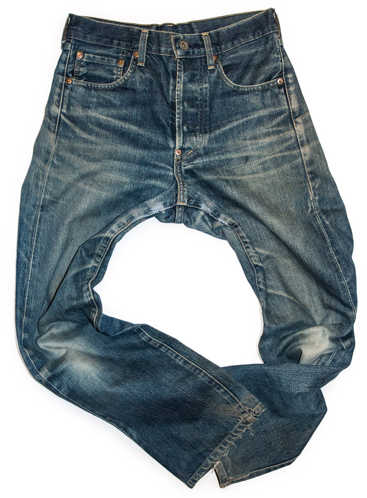 Naturally aged faded Levi's raw jeans with whiskers