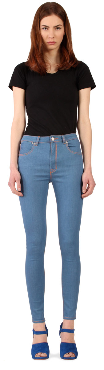 Model wearing rare Williamsburg vintage blue high waisted skinny jeans for women produced in 2013.