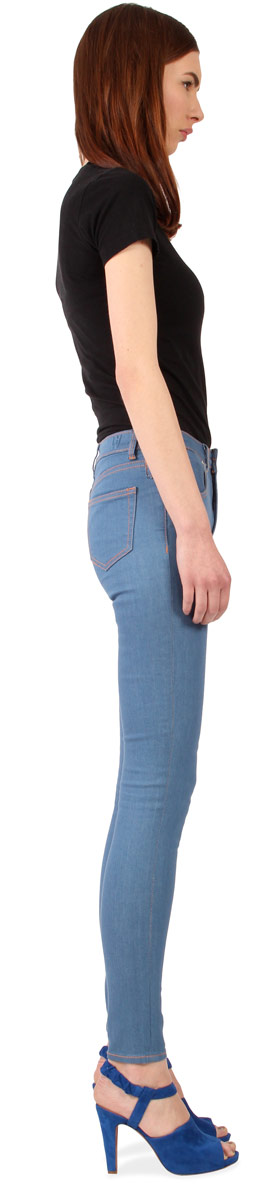 Side view of Williamsburg vintage blue high waisted skinny jeans for women.