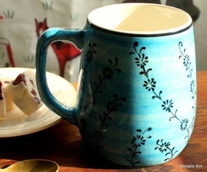 Hand painted ceramic coffee cups.  Hand wash.  Made in Turkey.