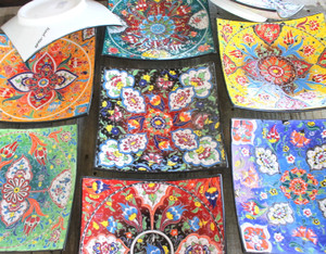 Large colourful ceramic hanging plates.  Beautifully hand painted in riots of colour in the Kabartma Style.