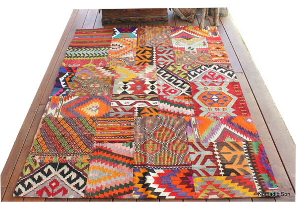 A fantastic Patchwork kilim that is more colourful and brighter than the others.  Each fragment is hand woven using hand spun wool.  Then machine stitched to stop fraying and finished with hand stitching with a backing.