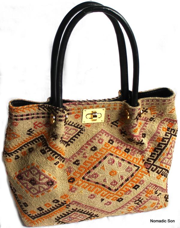 Cicm kilim and leather clasp handbag