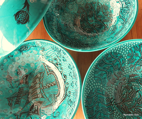 30cm handmade and hand painted ceramic bowls.  In a deep jade green with black intricate details.