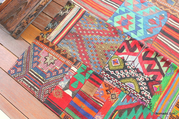 A fantastic Patchwork kilim that is more colourful and brighter than the others with a stunning jewel blue and green.  Each fragment is hand woven using hand spun wool.  Then machine stitched to stop fraying and finished with hand stitching with a backing.