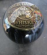 Brass token inside on SOLID black