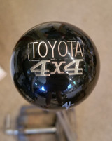 Toyota 4x4 vintage pin embedded inside top of knob.