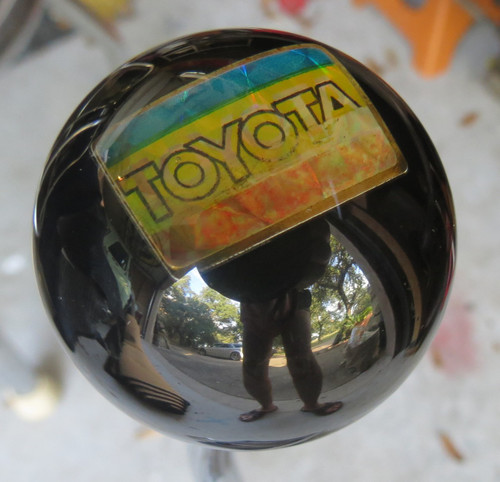 Old and distressed Toyota Pin embedded inside the knob, the knob you get may be slightly less faded or more colorful than the one shown - we make them as we find the pins.