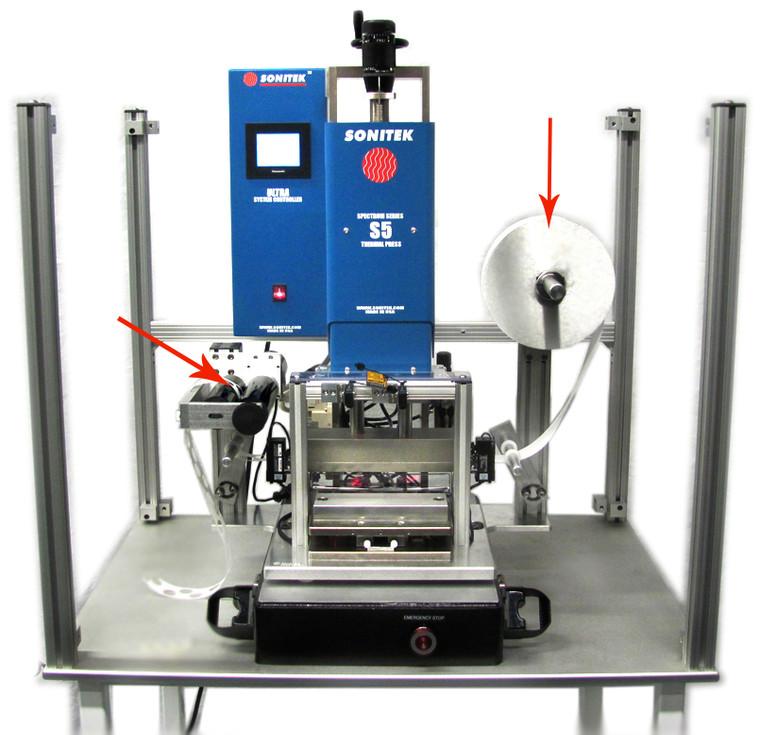 Film feeder on heat staking machine