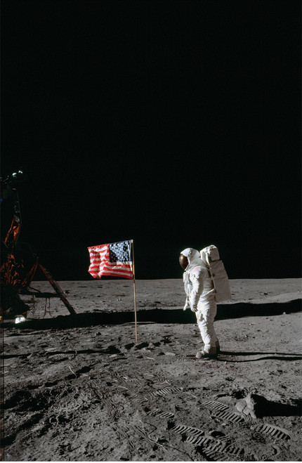 Neil Armstrong placing the American flag on the moon.