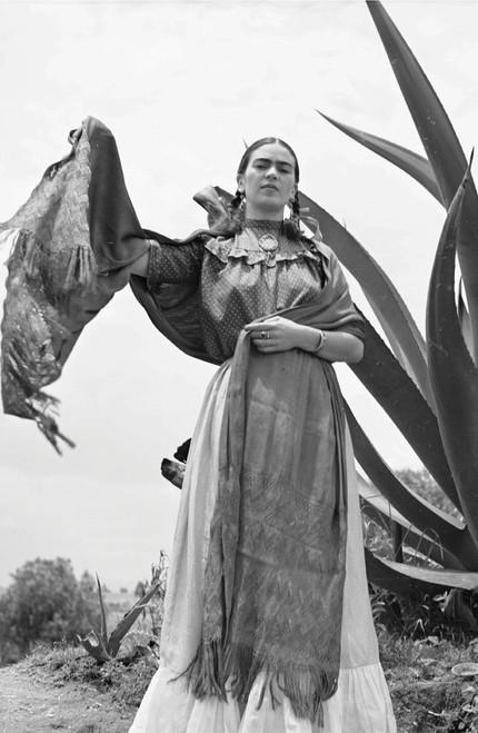 Frida Kahlo dancing in front of agave plant.