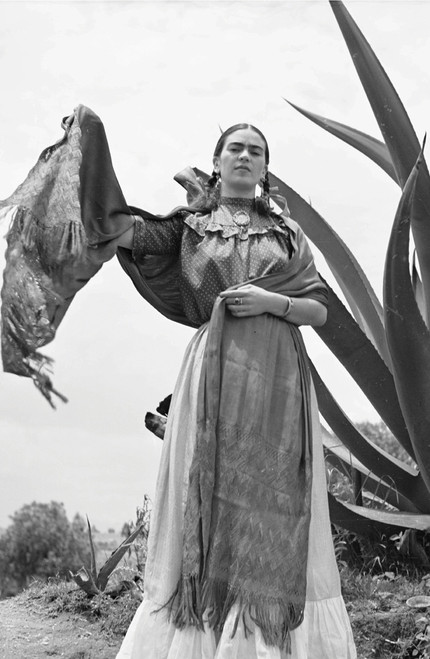 Frida Kahlo dancing in front of agave plant.