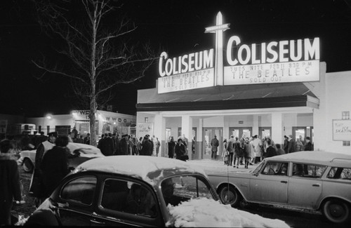 Photo of the Washington Coliseum with signage for a sold out Beatles concert.