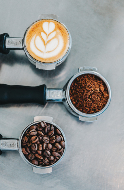 Espresso puck, latte art and coffee beans.