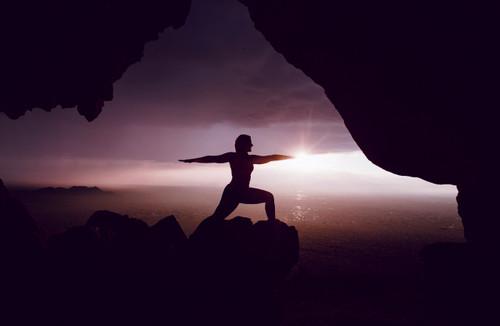 Yogi in warrior 2 pose.