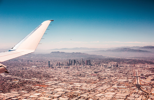 Photo of Los Angeles skyline from plane with blue sky.
