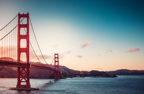 Golden Gate Bridge at sunrise over San Francisco bay.