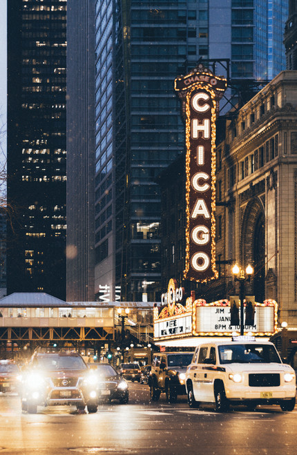 Illuminated Chicago Theatre at night.