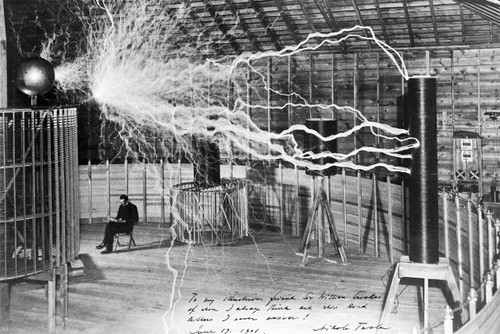 Photo of Nikola Tesla conducting a lab experiment.
