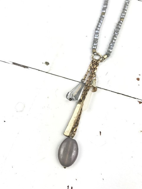 gold and gray necklace