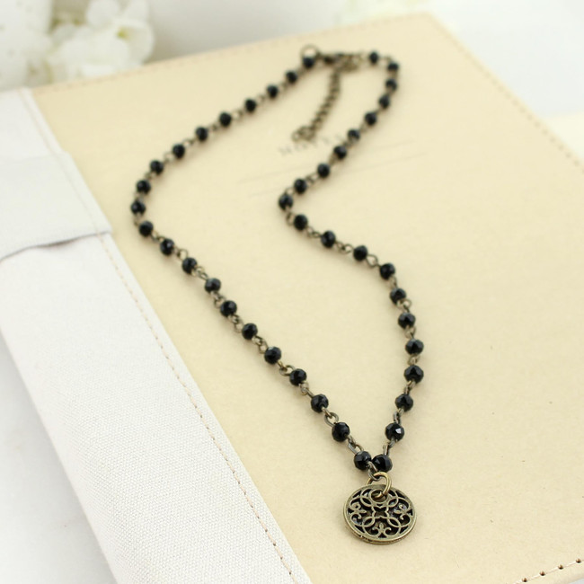 black crystal beaded necklace with filigree charm