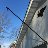 The Freedom 6' Flag pole, bracket and never furl mounted on a house. Made in U.S.A.