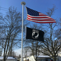 POW/MIA Double Face Flag flying proudly. 2'x3' under a 3'x5' American Flag on the 21' Flyin Glory. 100% Made in the U.S.A.