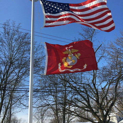 United States Marine Corps Flag flying proudly. 2'x3' under a 3'x5' American Flag on the 21' Classic Flag Pole. All 100% Made in the U.S.A.