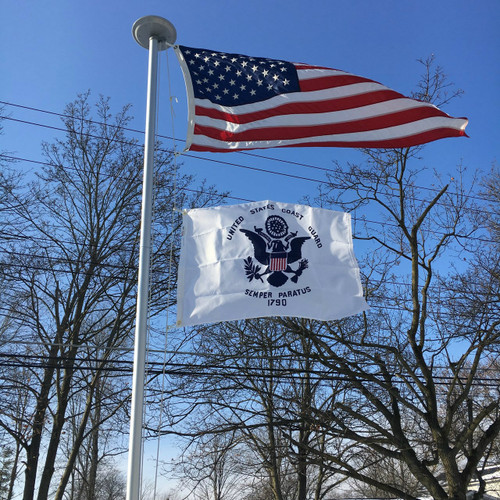 United States Coast Guard flying proudly. 2'x3' under a 3'x5' American Flag on the 21' Classic Flag Pole. All 100% Made in the U.S.A.