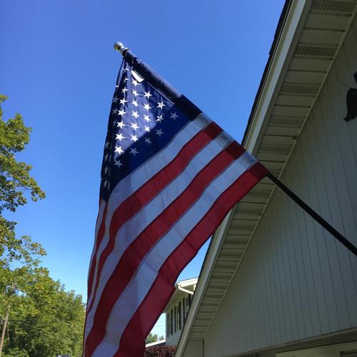 The Freedom 6' Pole & U.S. Flag Kit: 3'x5' Sleeved Flag, 2-position cast aluminum bracket & Never Furl flag attachment kit.