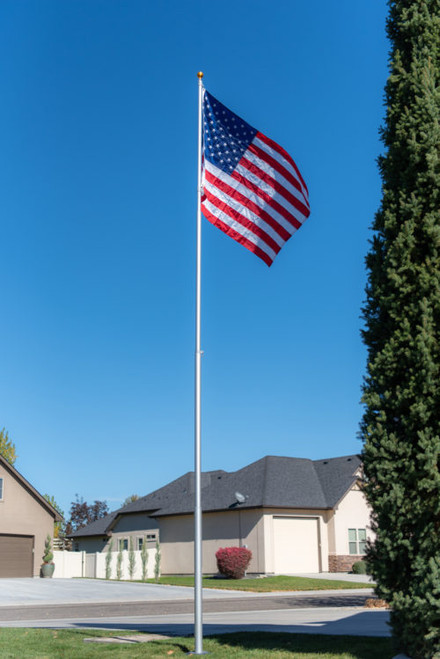20' Titan Telescoping flagpole, Silver finish, fully raised with the Titan Solar light and American Flag. All Made in the USA.