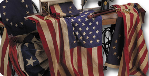 Photo of an assortment of historical American Flags on a sewing machine