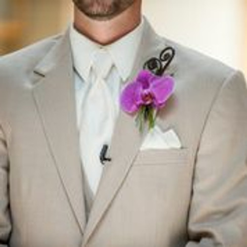 Phalaenopsis boutonniere with fern curls