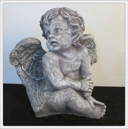 Seated cherub