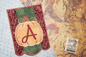 A is not included with this file. We are just keeping the  photograph as a sample for you to see the finalized stitched out product.