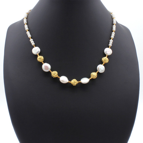 Freshwater coin and button pearls strung with copper accetns and 22k gold plated beads