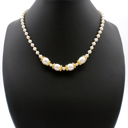 Lela oval and round freshwater pearl necklace with copper flower accents and 22k gold plated beads