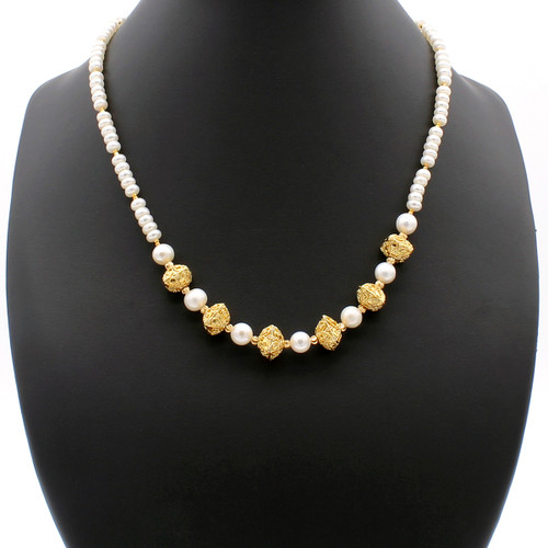 Loreley freshwater pearl necklace with 22k gold plated beads and copper cushion accents.
